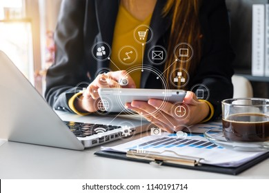 close up of businessman working with smart phone and laptop and digital tablet computer in modern office with virtual icon diagram
