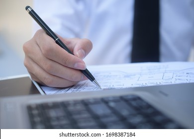 Close up businessman write on document work job in office