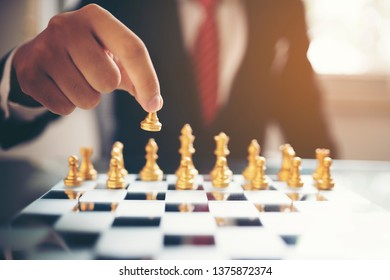 Close up businessman's hand playing chess game, business and teamwork concept
