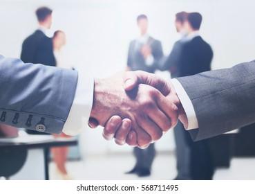 Close up of businessmen shaking hands