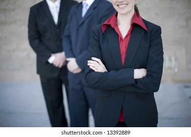 close up of businesspeople standing with arms crossed