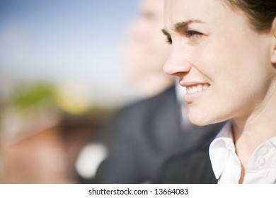 close up of businesspeople standing in a row looking in same direction