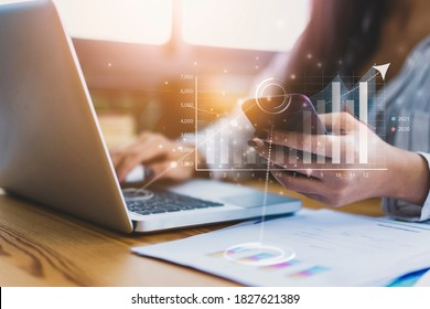 Close up businesswoman collecting data information converting into statistics, planning strategy gathering resources creating visual graphical graphs using computer laptop and smart mobile device