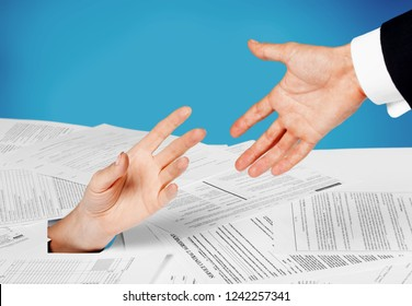 Close up of businesswoman hand in stack of papers