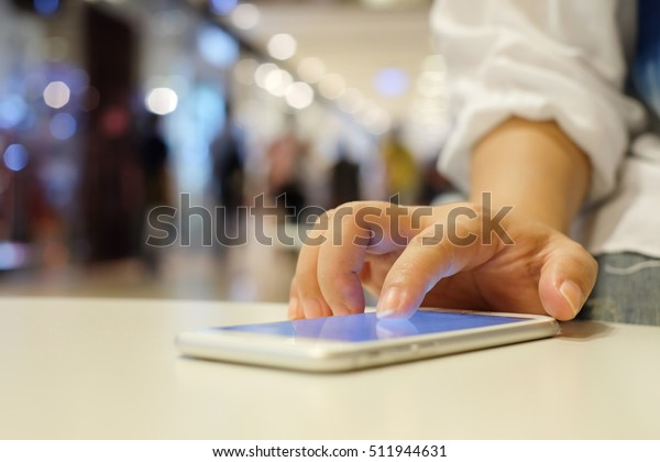 close up businesswoman hand swipe to unlock on smartphone touch screen for using application concept.