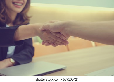 close up businesswoman handshake with partner,ceo leader hand shake for agreement or approve or deal financial,we are hiring concept
