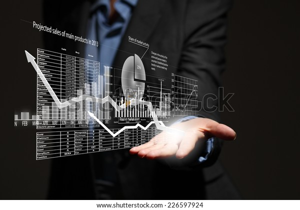 Close up of businesswoman holding graphs in hand