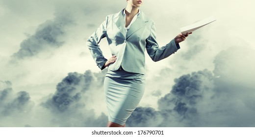 Close up of businesswoman holding papers in hands