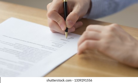 Close up businesswoman signing contract, putting signature on business document, candidate filling employment agreement, client taking loan, mortgage, making deal, female hands writing on paper