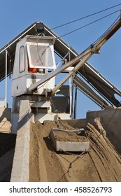 Close up of cabin and bucket with sand at concrete batching plant