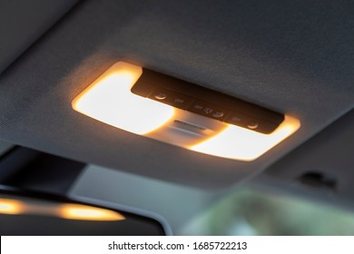 close up of cabin car ceiling lamp, light control panel inside interior.