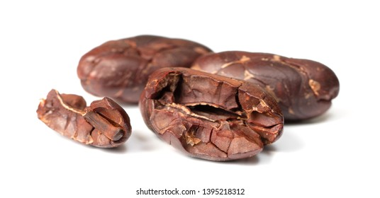 close up of cacao nibs isolated on white background