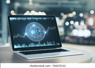 Close up of cafe table with digital bitcoin on laptop screen. Blurry background. Cryptocurrency and digitally concept. 3D Rendering