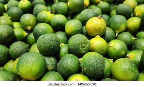 Close up of Calamansi green limes in market