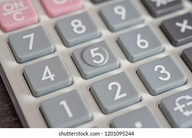 Close up calculator number buttons. Selective focus