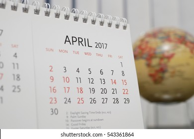 Close up calendar of April 2017 with blur earth globe background