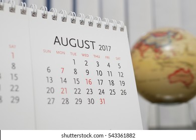 Close up calendar of August 2017 with blur earth globe background