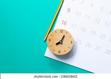 close up of calendar and clock on the green background, planning for business meeting or travel planning concept