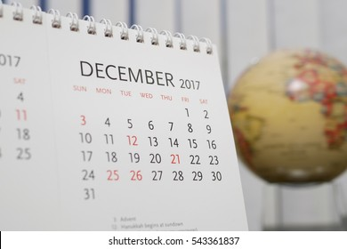 Close up calendar of December 2017 with blur earth globe background