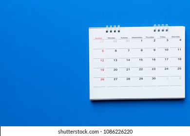 close up of calendar on blue background planning for business meeting or travel planning concept