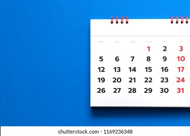 close up of calendar on blue background, planning for business meeting or travel planning concept