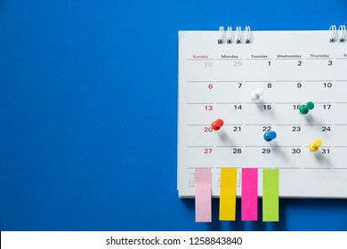close up of calendar on the blue table, planning for business meeting or travel planning concept