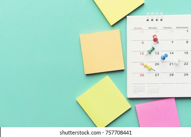 close up of calendar on green background, planning for business meeting or travel planning concept