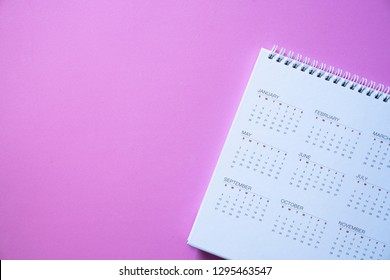 close up of calendar on the pink background, planning for business meeting or travel planning concept