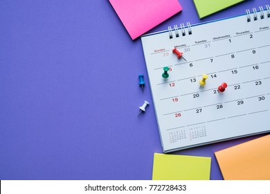 close up of calendar on the purple background, planning for business meeting or travel planning concept