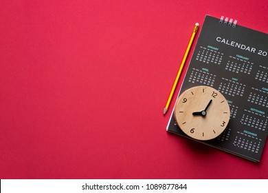 close up of calendar on red background, planning for business meeting or travel planning concept