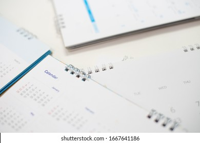 Close up Calendar on white table in planning concept.