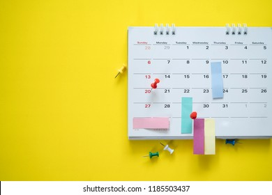 close up of calendar on the yellow background, planning for business meeting or travel planning concept