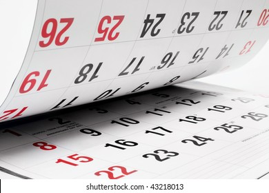 Close up of Calendar Pages on Seamless White Background