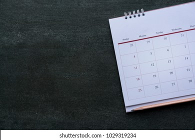close up of calendar and pencil on the table, planning for business meeting or travel planning concept