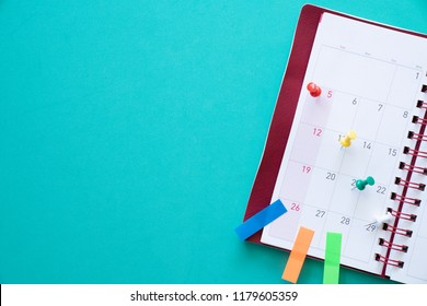 close up of calendar, planner on the green table, planning for business meeting or travel planning concept