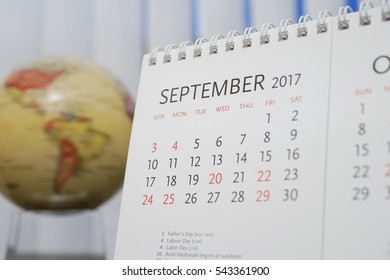 Close up calendar of September 2017 with blur earth globe background