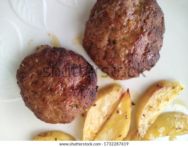 close up of calf burgers with potatoes