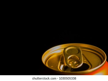 Close up can of beer on a black background
