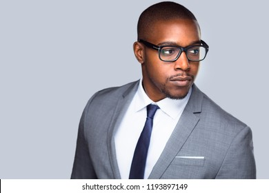 Close up candid, swanky, stylish, handsome, businessman, executive, modern glasses isolated on grey
