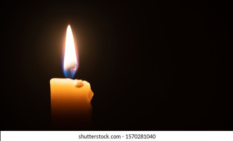 close up candle light in the dark macro photography texture background