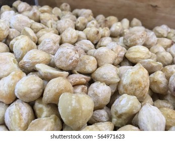 Close up of candlenuts in a box storage. Candlenut or Aleurites moluccanus is a very healthy food known to be an organic supplement fpr various health purposes.