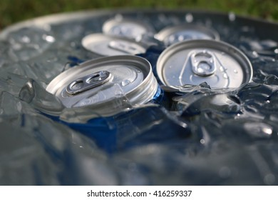 Close up cans in ice.