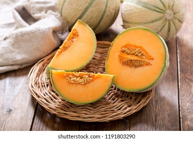 close up of cantaloupe melon on wooden table