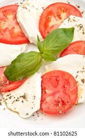 Close up of Caprese salad - tomatoes, mozzarella and basil