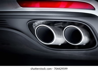 Close up of car exhaust pipe.