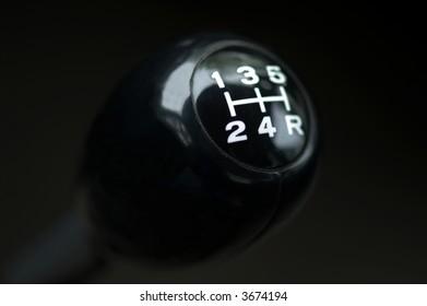 Close up of a car gear shift. Stick shift.