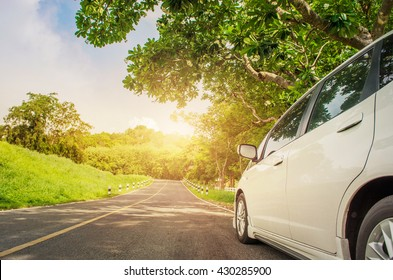 Close up car on asphalt road in summer, Beautiful nature and sunlight.