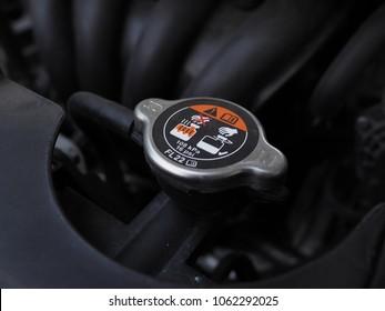 Close up Car radiator cap in the engine room