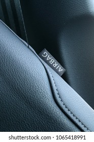 close up of car seat. textile tag: AIRBAG