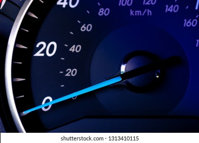 Close up of car speedometer with speed indicating 0. No progress concept